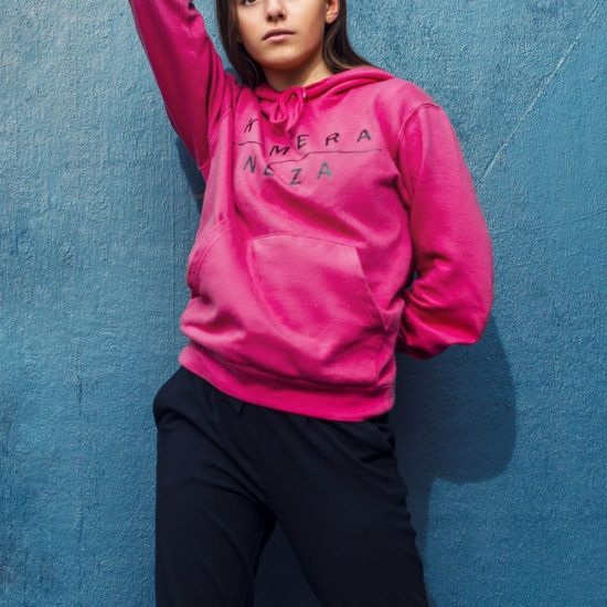young woman in pink hoodie from KOMERA NEZA dance school