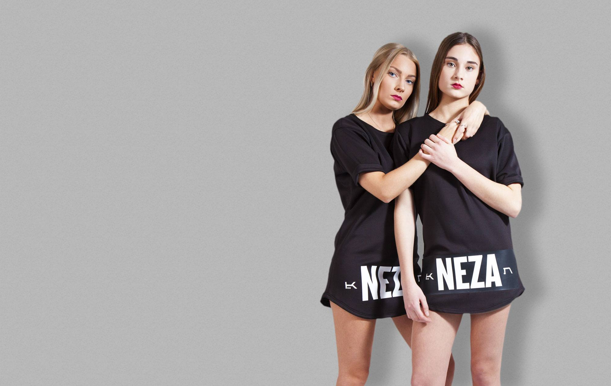 Two women in black t-shirts from KOMERA NEZA dance school